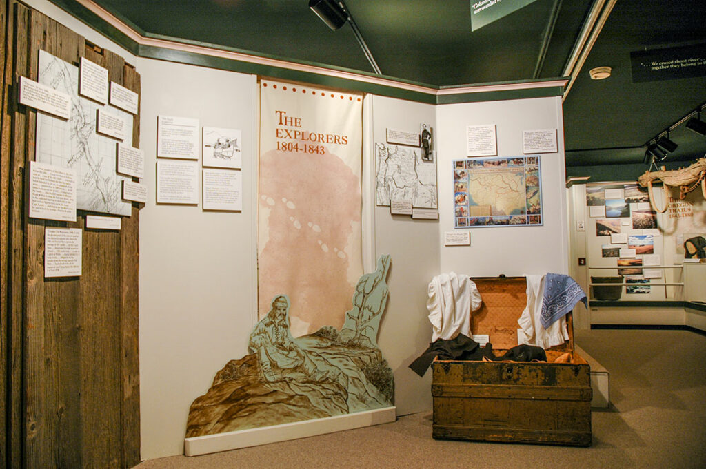 The Oregon Trails, Rails and Roads in Sherma County exhibit section banner and cutout.  Photo by Cameron Kaseberg.