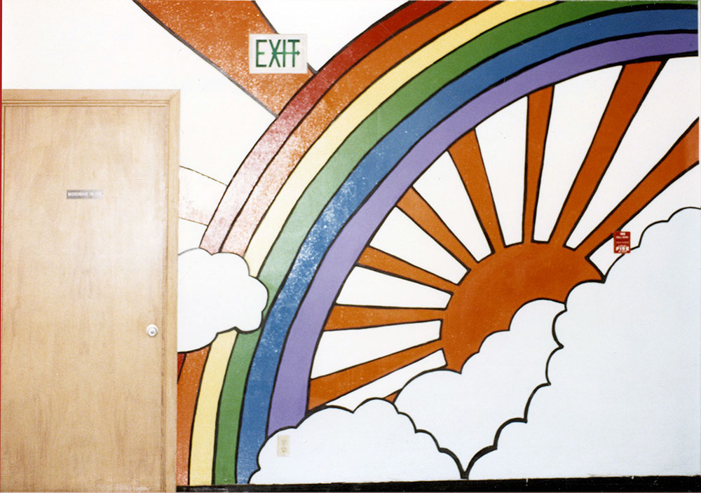 Rainbow mural on the north end of the of the hallway at Sherman Union High School by Kim Kaseberg and Cameron Kaseberg, 1980. Photo by Cameron Kaseberg.
