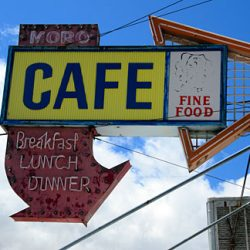 A cafe sign on an old commercial building in downtown Moro. Gary Halvorson, Oregon State Archives.